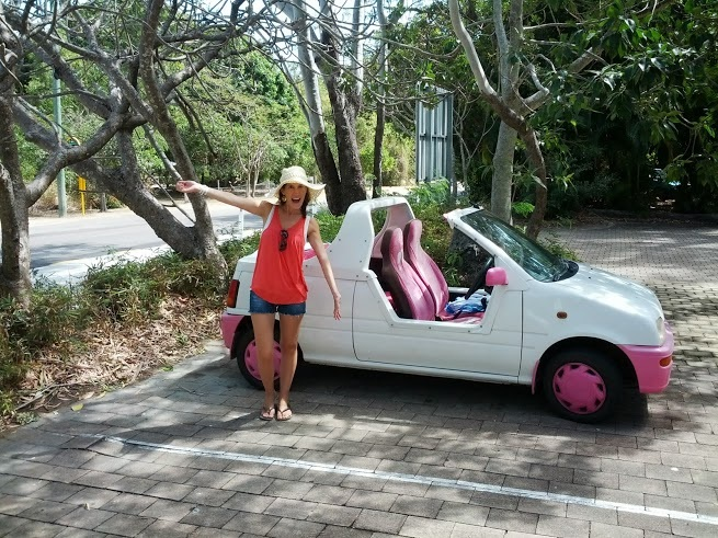 Standing in front of a typical Magnetic Island moke. It was a life-sized Barbie car! & Beyond Voyage Blog - Follow Our Journey - Beyond Voyage